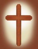 Cruz adornada de madera de la nuez de Brown con el símbolo cristiano del fondo del pergamino de la resurrección Foto de archivo libre de regalías