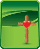 Cruz con el corazón en fondo verde Imágenes de archivo libres de regalías
