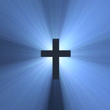 Cruz con las flamas ligeras azules Foto de archivo libre de regalías