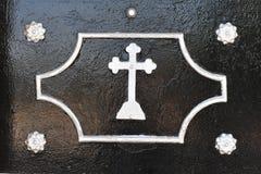 Cruz cristiana de la puerta Foto de archivo libre de regalías