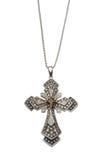 Cruz cristiana del oro en un encadenamiento Imágenes de archivo libres de regalías