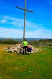 Cruz de Atapuerca cross in Saint James Way bike stock image