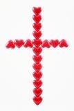 Cruz de corazones rojos Imagen de archivo