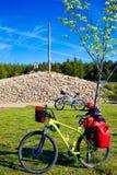 Cruz de Ferro top at Saint James Way Leon bikes. Cruz de Ferro top at Saint James Way bikes Leon Spain Stock Image