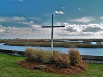Cruz de la entrada de Murrells en el pantano Imágenes de archivo libres de regalías