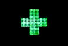 Cruz de la luz de una farmacia Imagen de archivo libre de regalías
