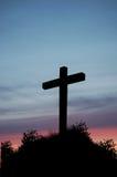 Cruz de la puesta del sol Fotos de archivo