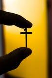 Cruz de la silueta Fotografía de archivo libre de regalías