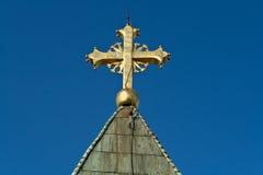 Cruz de oro en iglesia Imagen de archivo libre de regalías