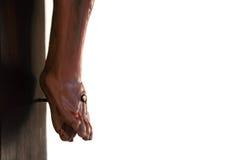 Cruz - detalle de los pies de Jesús Foto de archivo libre de regalías