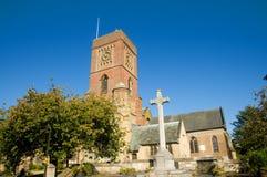A cruz e a igreja Foto de Stock
