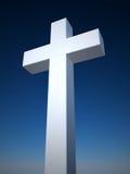 Cruz en fondo del cielo azul Imagen de archivo libre de regalías