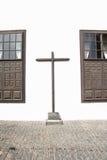 Cruz entre dos Windows Fotografía de archivo libre de regalías