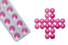Cruz feita dos comprimidos Foto de Stock