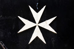 Cruz maltesa. Imagenes de archivo