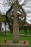 Cruz medieval con símbolos arhaic en el monasterio del humor, Moldavia, Rumania Imagen de archivo libre de regalías