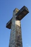 Cruz no céu azul Imagens de Stock Royalty Free