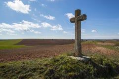 A cruz no campo Foto de Stock Royalty Free