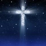 Cruz religiosa de incandescência nas estrelas Fotos de Stock Royalty Free