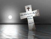 Cruz religiosa en agua Foto de archivo libre de regalías