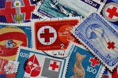 Cruz Roja en sellos Imagen de archivo libre de regalías