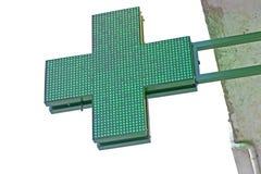 Cruz verde de la farmacia Imágenes de archivo libres de regalías