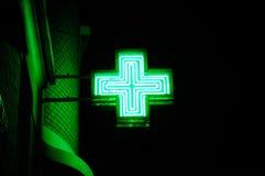 Cruz verde de neón Fotografía de archivo