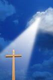 Cruz y luz de arriba Imágenes de archivo libres de regalías