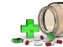 Cruz y píldoras verdes Foto de archivo