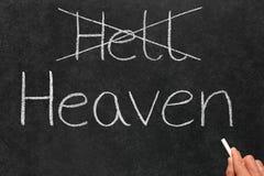 Cruzando hacia fuera infierno y la escritura de cielo. Foto de archivo libre de regalías
