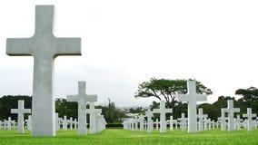 Cruzes de mármore em um cemitério Fotografia de Stock