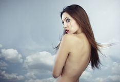 Cry. Ing lady with perfect creative makeup at the sky background stock image