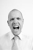 The cry. Young man is shouting loud Stock Photos