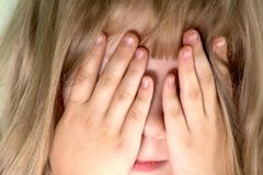 Cry. An image of girl hiding her face Stock Image
