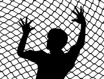 Cry for Liberty. Destitute person behind the fence as prisoner of war symbol Stock Photography