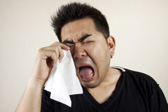 Cry like a baby. A man in black shirt crying like a baby Stock Images