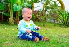 Cry sad boy (yellow, China) Royalty Free Stock Image