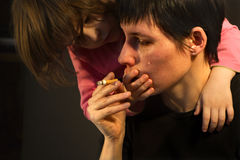 Cry of the woman with the cigarette. And daugheter Stock Photos