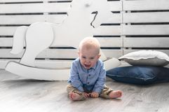 Crybaby boy sittin on the floor. Baby crying and screaming. Stock Photography