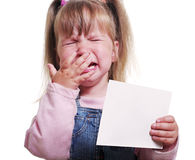 Cryind girl. Cryind girl in the old wear is keeping blank  sheet Royalty Free Stock Photography