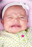 Crying. Baby crying with a Hair band in head Stock Photo