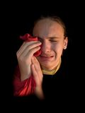 Crying. Kid on a black background Royalty Free Stock Photography