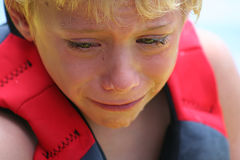 Crying. Upset boy crying lots of tears Royalty Free Stock Photos
