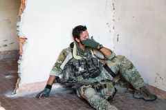 Crying American Soldier. Portrait of Crying American Soldier Resting from Military Operation; Indoor Ruins Location Stock Photos
