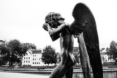 Crying Angel. In black and white with a Minsk city on the background Stock Photo