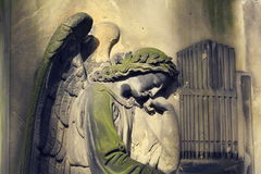 Crying angel organist tombstone on Malostransky cemetery, Prague, Czech republic Stock Photos