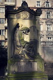 Crying angel organist tombstone on Malostransky cemetery, Prague, Czech republic Royalty Free Stock Image