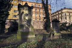 Crying angel organist tombstone on Malostransky cemetery, Prague, Czech republic Stock Images