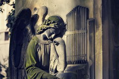 Crying angel organist tombstone on Malostransky cemetery, Prague, Czech republic Royalty Free Stock Photo