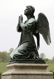 Crying angel sculpture. Old sculpture, crying angel on the stone Royalty Free Stock Photo
